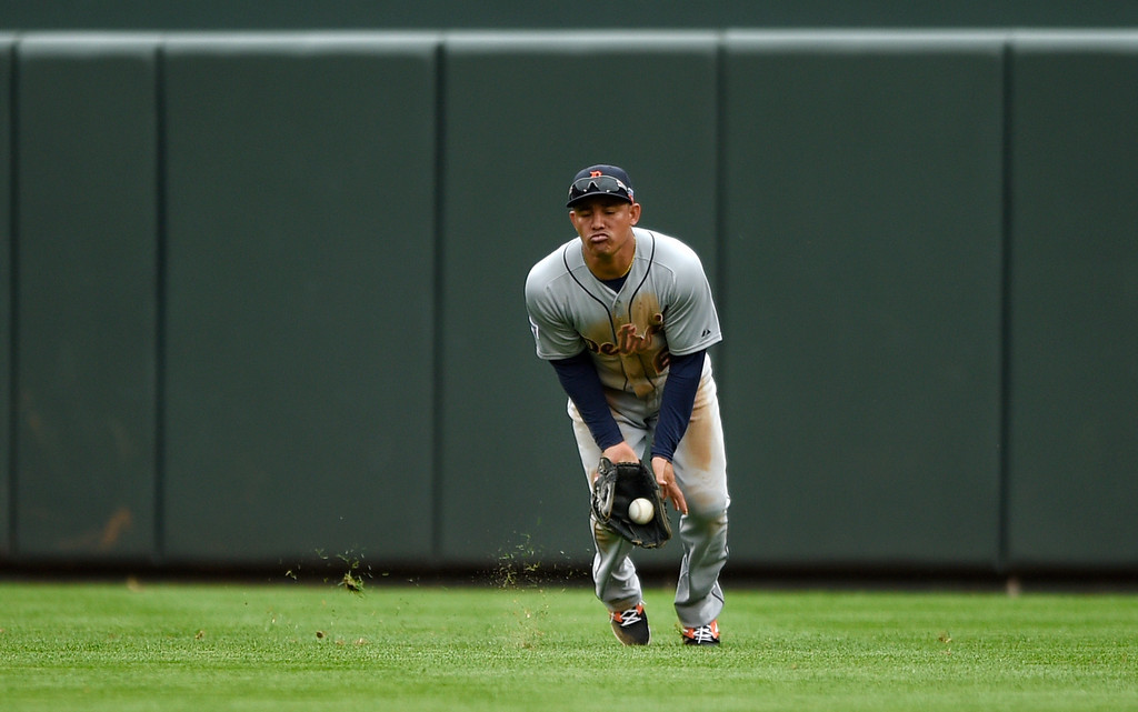 . Detroit Tigers center fielder Ezequiel Carrera fields a fly ball single by Baltimore Orioles\' Nelson Cruz in the sixth inning of Game 2 in baseball\'s AL Division Series in Baltimore, Friday, Oct. 3, 2014. (AP Photo/Nick Wass)