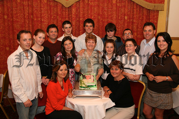 Mrs Mary Campbell from Carrivemaclone is pictured cutting her 70th birthday cake at a party in the Golf Inn with family and friends, Pictured with Mary are her children Sean, Pat, Eugene, Paul, Cecilia, Theresa and Geraldine and grandchildren, Many of Marys friends from Cloughogue Pitch + Putt club were present at the party. 07W35N72