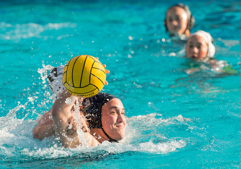 . La Serna High\'s Gabby Pierandozzi is fouled while taking a goal shot vs Temple City High in the CIF-SS girls water polo first-round game at Whittier High Feb. 14, 2013.   (SGVN/Staff photo by Leo Jarzomb)