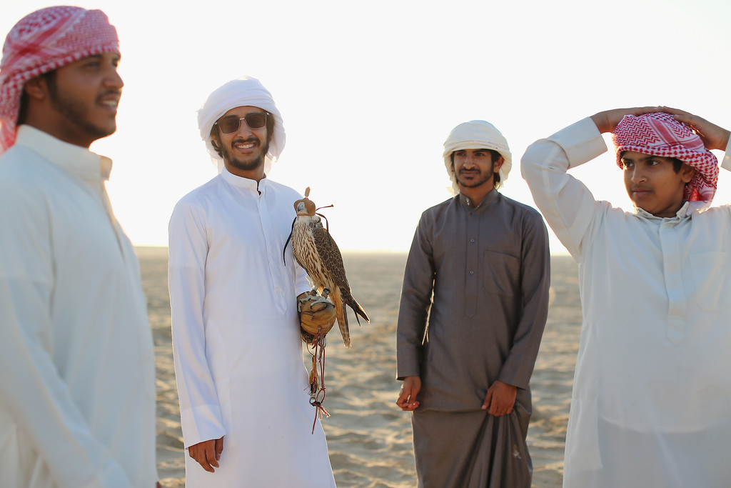 . Emirati men gather with their Falcons on February 3, 2015 in Abu Dhabi, United Arab Emirates. (Photo by Dan Kitwood/Getty Images)