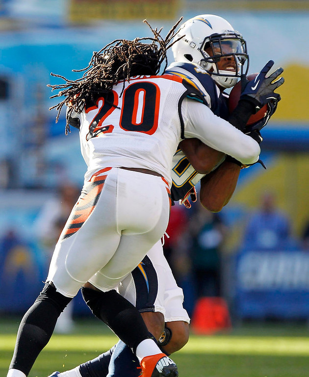 . Cincinnati Bengals free safety Reggie Nelson (20) stops San Diego Chargers wide receiver Danario Alexander (84) after catching a pass for 18 yards in the first half of their NFL football game in San Diego, California December 2, 2012.  REUTERS/Alex Gallardo