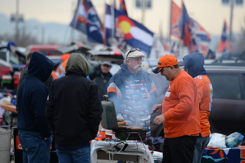 . Broncos fans tailgate before the game. The Denver Broncos played the Indianapolis Colts in an AFC divisional playoff game at Sports Authority Field at Mile High in Denver on January 11, 2015. (Photo by Craig F. Walker/The Denver Post)