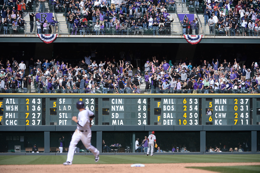 . Carlos Gonzalez watches fans react to his sixth inning home run as he rounds the bases. The Colorado Rockies hosted the Arizona Diamondbacks in the Rockies season home opener at Coors Field in Denver, Colorado Friday, April 4, 2014. (Photo by Karl Gehring/The Denver Post)