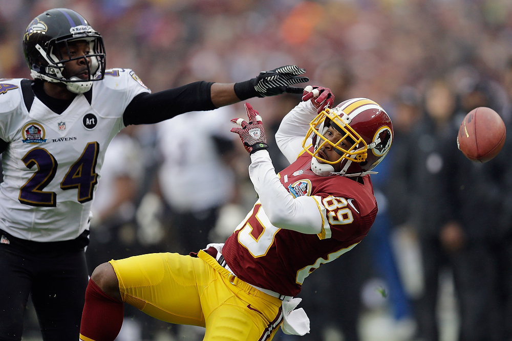 . LANDOVER, MD - DECEMBER 09: Cornerback Corey Graham #24 of the Baltimore Ravens breaks up a pass intended for wide receiver Santana Moss #89 of the Washington Redskins during the first half at FedExField on December 9, 2012 in Landover, Maryland.  (Photo by Rob Carr/Getty Images)