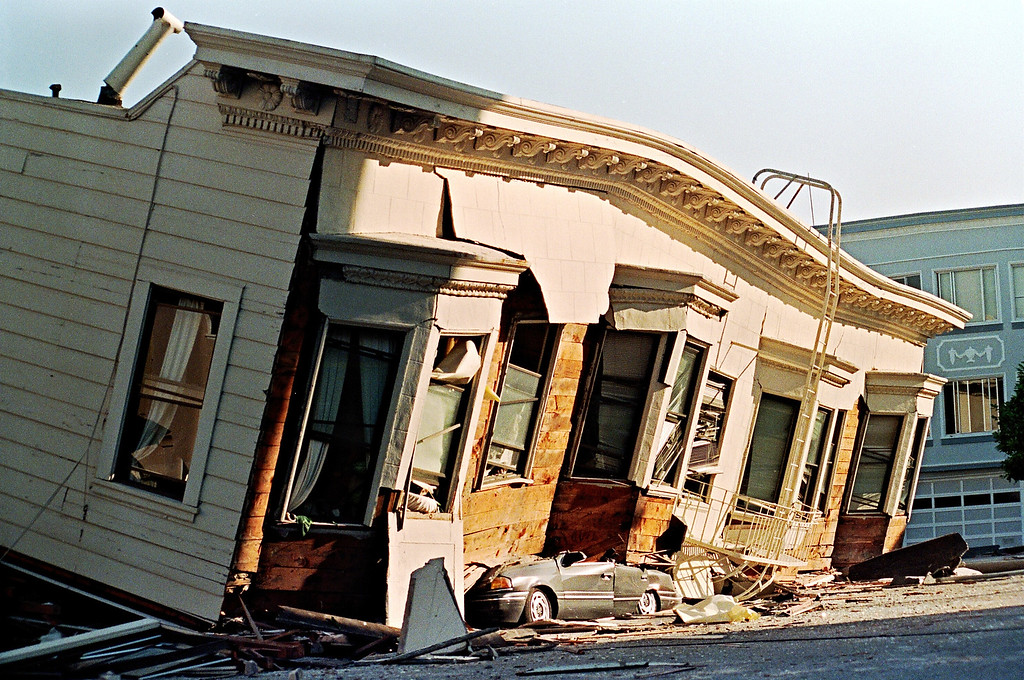 . Picture dated 18 October 1989 in San Francisco of a collapsed house that crushed a car parked on the street in the Marina District during a quake that hit the city 17 October measuring 6.9. Homes and offices were wrecked, fires broke out and vital services were cut off.  (ADAM TEITELBAUM/AFP/Getty Images)