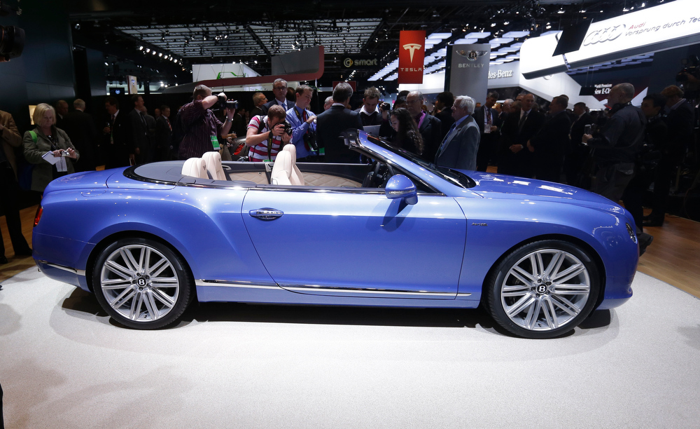 . Bentley Chairman and CEO Wolfgang Schreiber unveils the GT Speed Convertible during the North American International Auto Show in Detroit, Monday, Jan. 14, 2013. (AP Photo/Carlos Osorio)