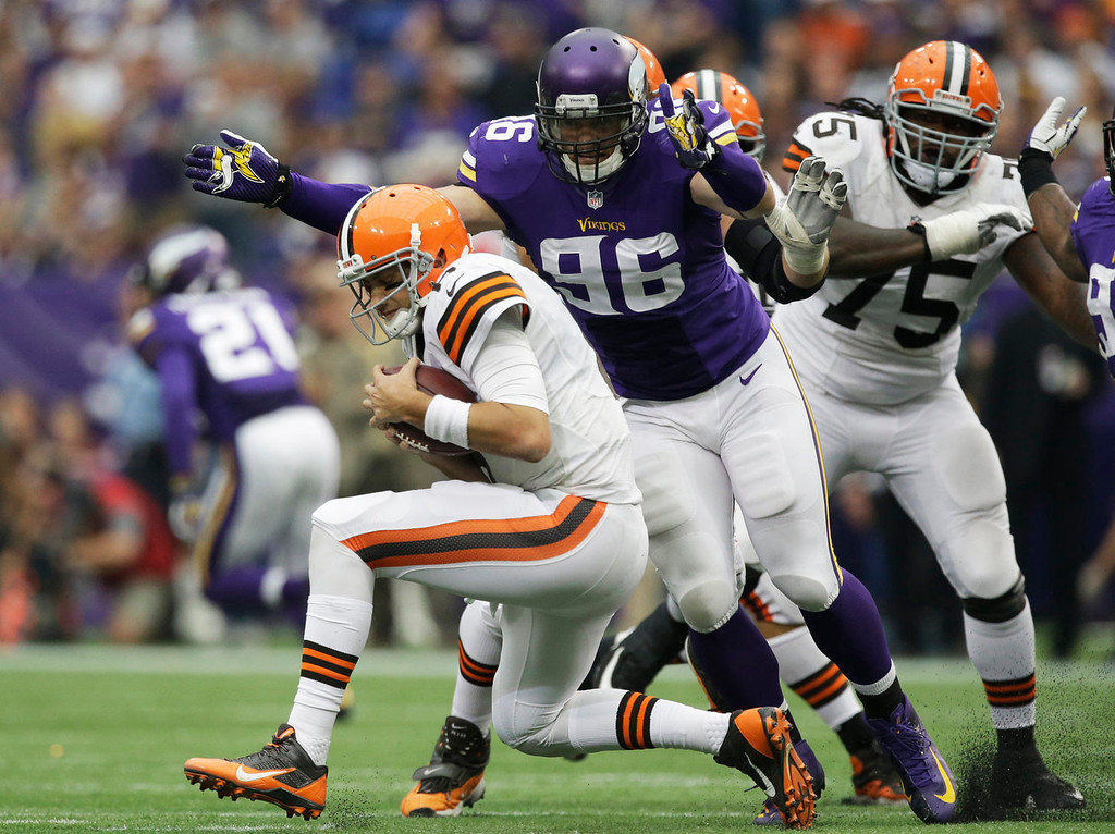 . Minnesota Vikings defensive end Brian Robison (96) sacks Cleveland Browns quarterback Brian Hoyer, left, during the second half of an NFL football game Sunday, Sept. 22, 2013, in Minneapolis. (AP Photo/Jim Mone)