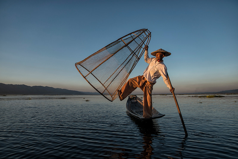 A fisherman balancing on one leg on Inle Lake.  Myanmar 2017.
