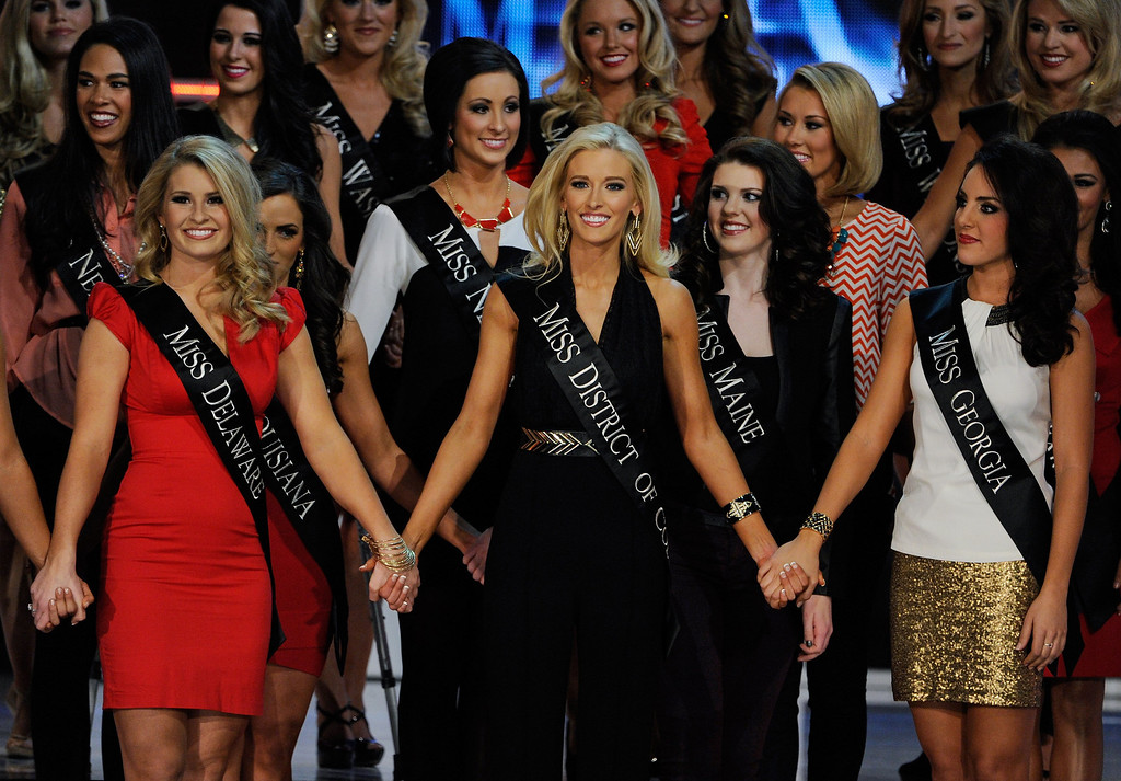 . (L-R) Alyssa Murray, Miss Delaware, Allyn Rose, Miss District of Columbia and Leighton Jordan, Miss Georgia hold hands during the 2013 Miss America Pageant at PH Live at Planet Hollywood Resort & Casino on January 12, 2013 in Las Vegas, Nevada.  (Photo by David Becker/Getty Images)
