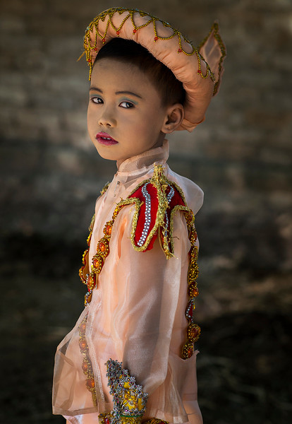 A young boy dressed up for the novice hood initiation. A very important ceremony.  Myanmar 2017