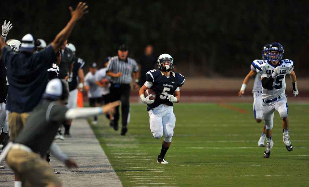 . St. John Bosco football takes on Chandler, Airzona as part of the Mission Viejo Classic in Mission Viejo, CA on Saturday, September 14, 2013. St. John Bosco won 52-31.  Bosco\'s Sean McGrew sprints down the sideline for a long TD run in the 4th qtr. (Photo by Scott Varley, Press-Telegram)