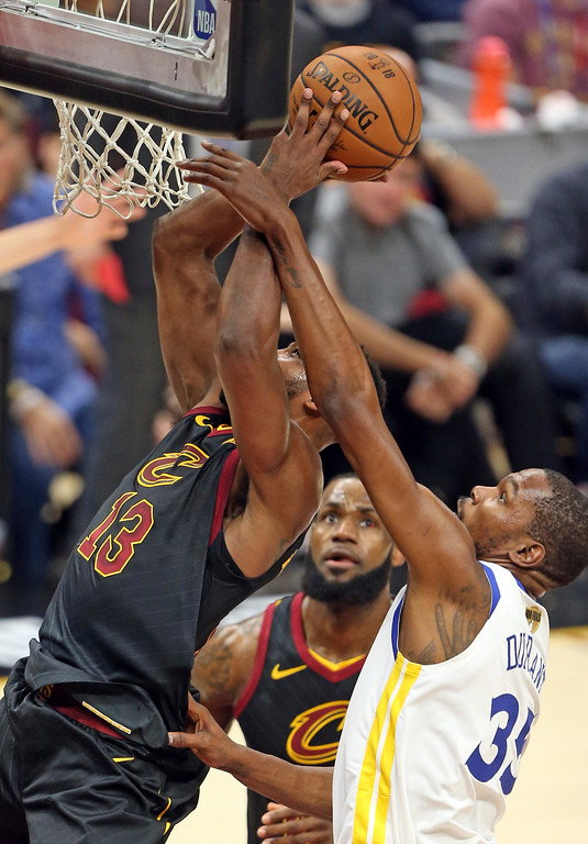 . Cleveland Cavaliers center Tristan Thompson shoots as Golden State Warriors forward Kevin Durant, right, defends during the first half of Game 3 of basketball\'s NBA Finals on Wednesday, June 6, 2018, in Cleveland. (Joshua Gunter/Cleveland.com via AP)