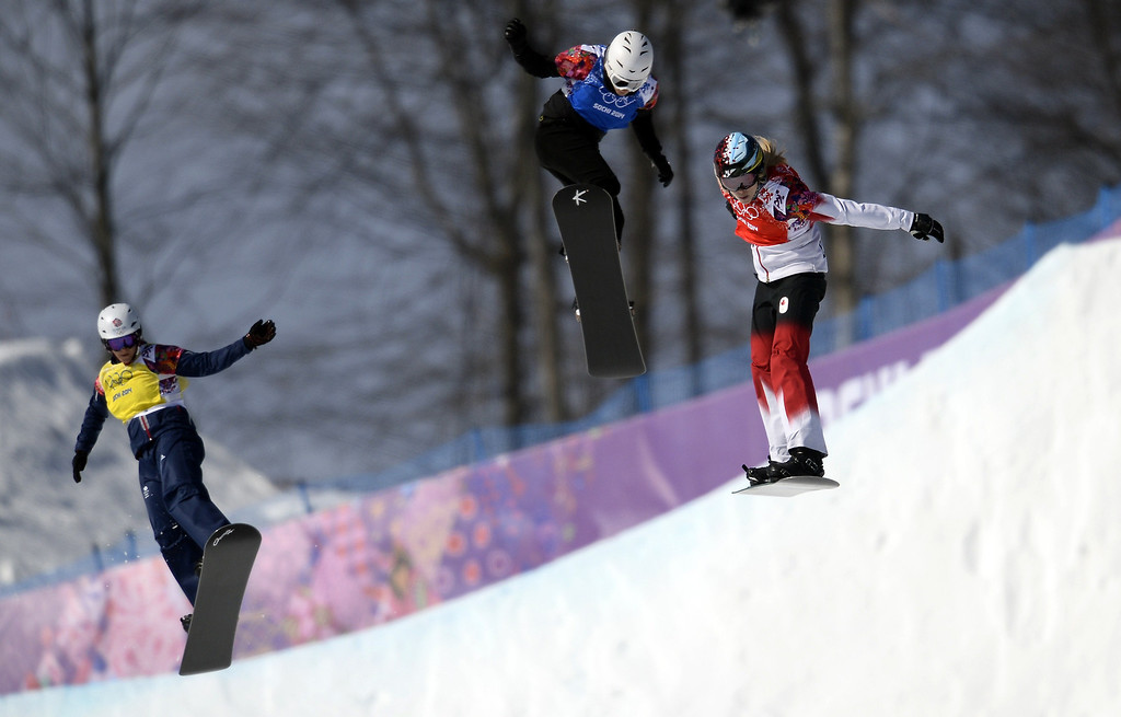 . Great Britain\'s Zoe Gillings (L), Bulgaria\'s Alexandra Jekova and Canada\'s Dominique Maltais compete in the Women\'s Snowboard Cross Quarterfinals at the Rosa Khutor Extreme Park during the Sochi Winter Olympics on February 16, 2014.   FRANCK FIFE/AFP/Getty Images
