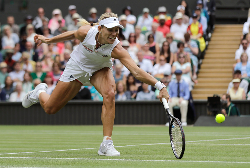 . Germany\'s Angelique Kerber returns the ball to Russia\'s Daria Kasatkina, during their women\'s singles quarterfinals match at the Wimbledon Tennis Championships, in London, Tuesday July 10, 2018. (AP Photo/Ben Curtis)