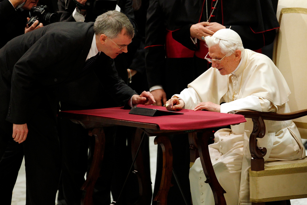 Description of . Pope Benedict XVI posts his first tweet using an iPad tablet after his Wednesday general audience in Paul VI's Hall at the Vatican December 12, 2012. REUTERS/Giampiero Sposito