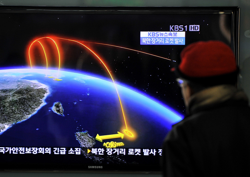 . A man watches a TV screen broadcasting news on North Korea\'s rocket launch, at a railway station in Seoul on December 12, 2012. North Korea on December 12 launched a long-range rocket which Japanese authorities said passed over its southern island chain of Okinawa. It was the second launch this year, after a failed attempt in April.  JUNG YEON-JE/AFP/Getty Images