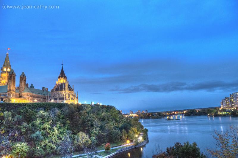 Parliament Hill & the Parliamentary Library along the Ottawa river, Ottawa, Ontario (Canada).