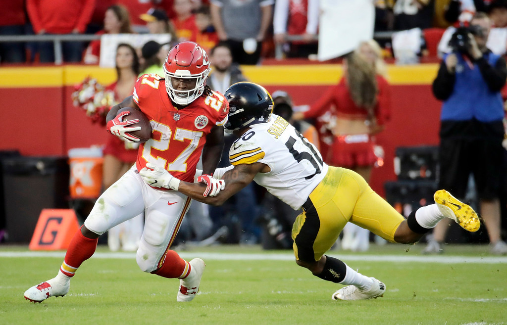 . Kansas City Chiefs running back Kareem Hunt (27) is tackled by Pittsburgh Steelers linebacker Ryan Shazier (50) during the second half of an NFL football game in Kansas City, Mo., Sunday, Oct. 15, 2017. (AP Photo/Charlie Riedel)