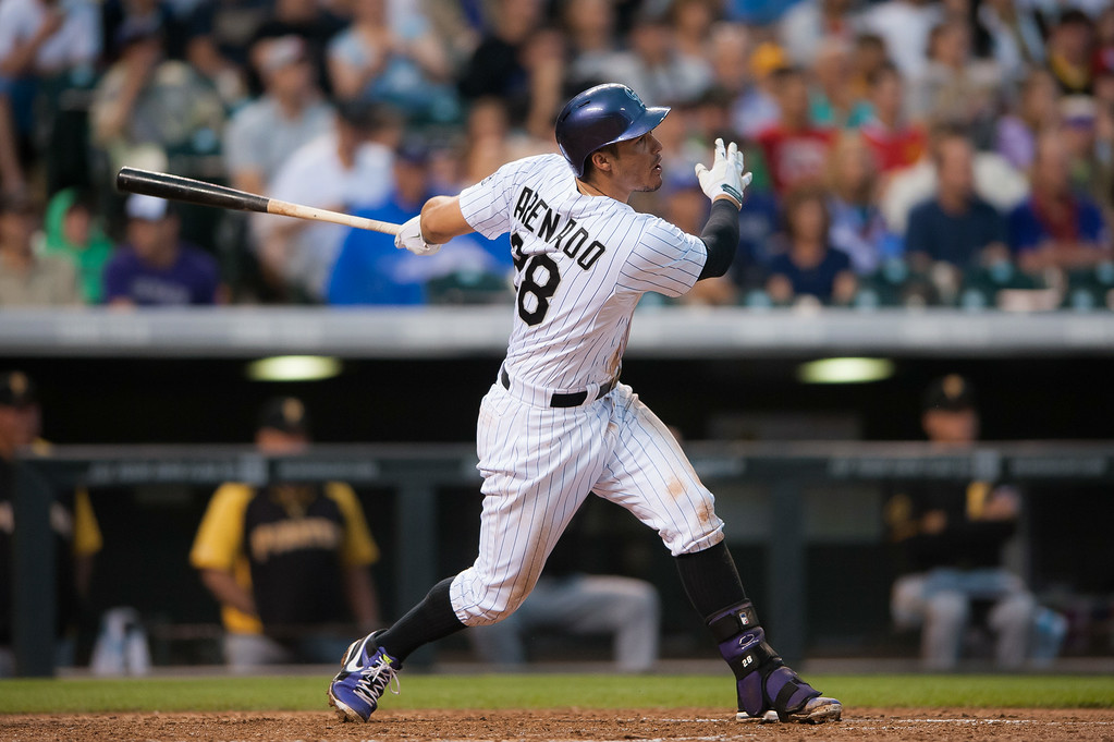 . Nolan Arenado #28 of the Colorado Rockies hits an RBI single in the fifth inning of a game against the Pittsburgh Pirates at Coors Field on July 26, 2014 in Denver, Colorado.  (Photo by Dustin Bradford/Getty Images)