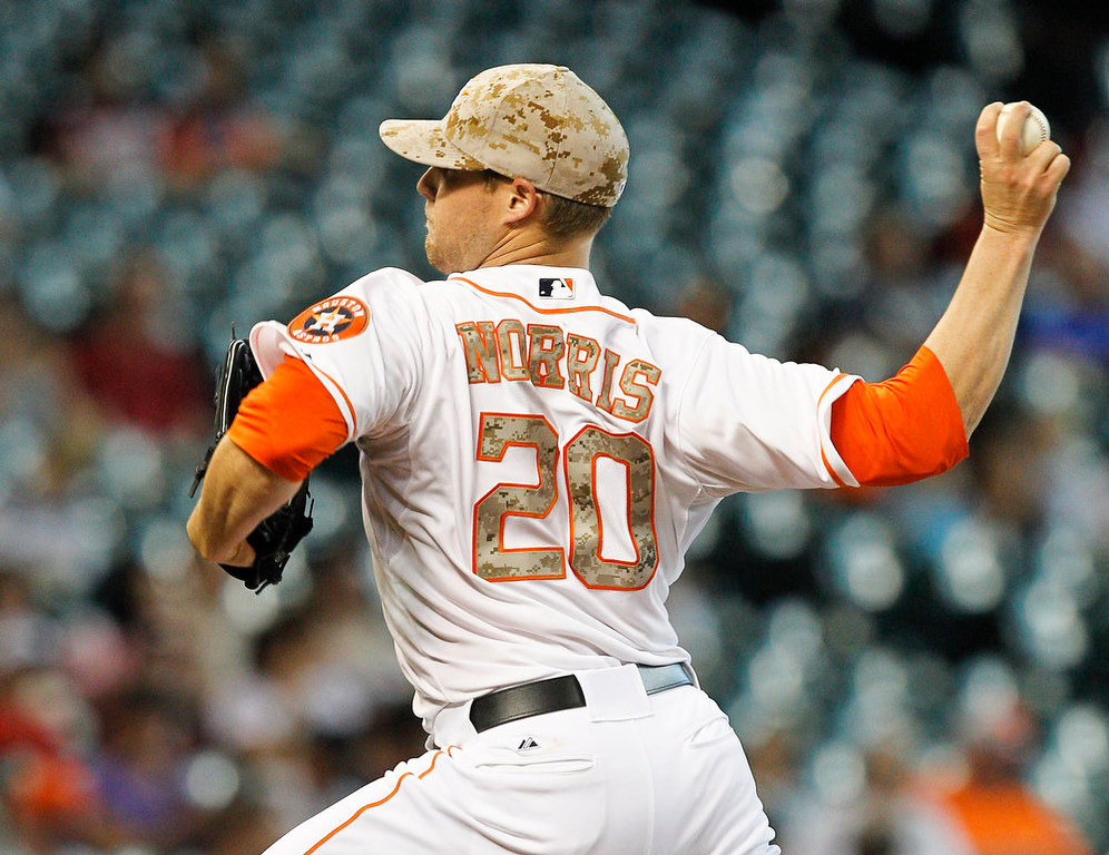 . Houston Astros starting pitcher Bud Norris (20) throws in the first inning against the Colorado Rockies during a baseball game, Monday, May 27, 2013, in Houston. (AP Photo/Bob Levey)