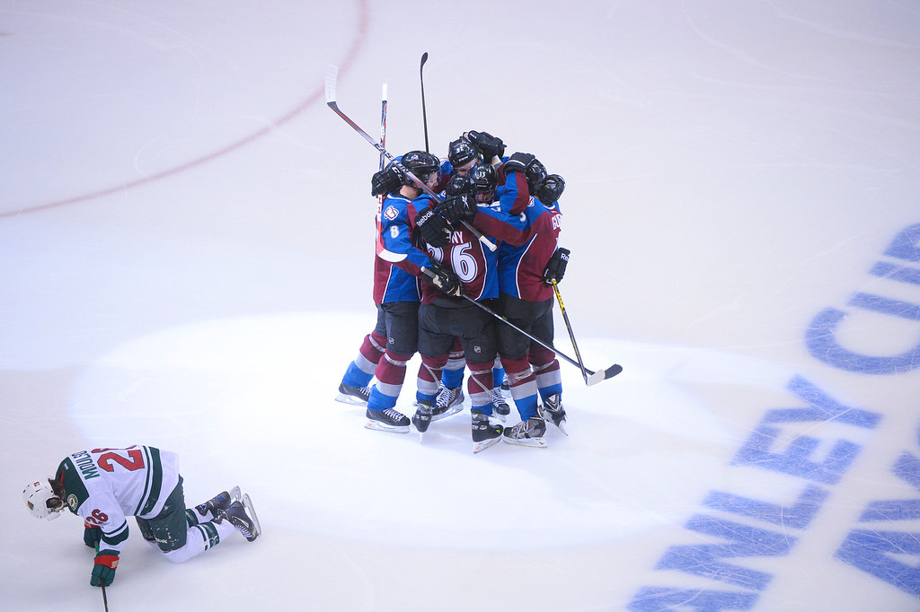 . Avalanche players celebrate a goal by Paul Stastny (26) of the Colorado Avalanche during the third period of action.  (Photo by Karl Gehring/The Denver Post)