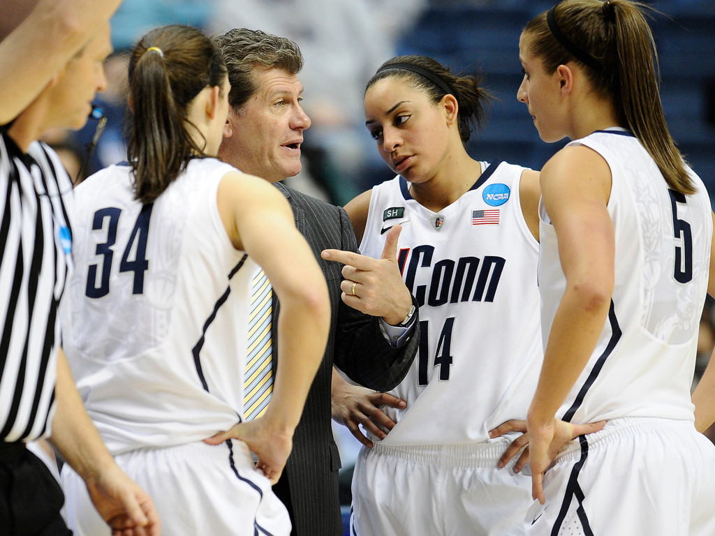 . Connecticut head coach Geno Auriemma, second from left speaks with players Kelly Faris, left, Bria Hartley, second from right, and Caroline Doty, right, during the second half of a first-round game against Idaho in the women\'s NCAA college basketball tournament in Storrs, Conn., Saturday, March 23, 2013. Connecticut won 105-37. (AP Photo/Jessica Hill)
