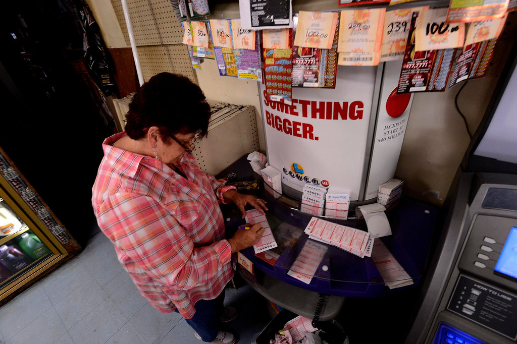 . Gloria Ybarra, of Fontana, buys a Powerball ticket at Quicker Liquor along Sierra Avenue in Fontana May 17, 2013.  The Powerball Lottery, which California just joined earlier this year, is at $600 million for Saturday\'s drawing.  It is the third-highest jackpot in U.S. history.  GABRIEL LUIS ACOSTA/STAFF PHOTOGRAPHER.