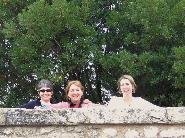 Cathy, Judy and Julie looking over cemetary wall