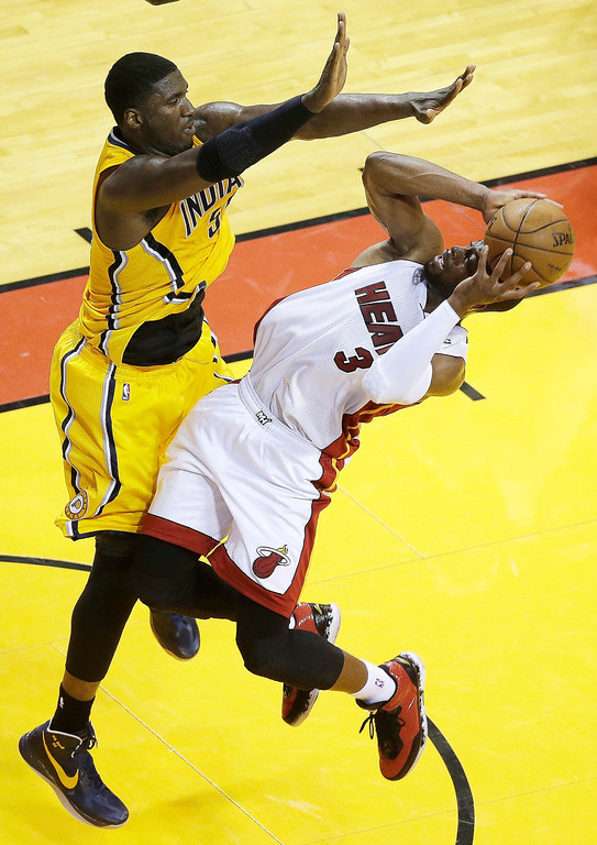 . Miami Heat shooting guard Dwyane Wade (3) shoots under pressure from Indiana Pacers center Roy Hibbert (55) during the first half of Game 7 in their NBA basketball Eastern Conference finals playoff series, Monday, June 3, 2013 in Miami. (AP Photo/Wilfredo Lee)