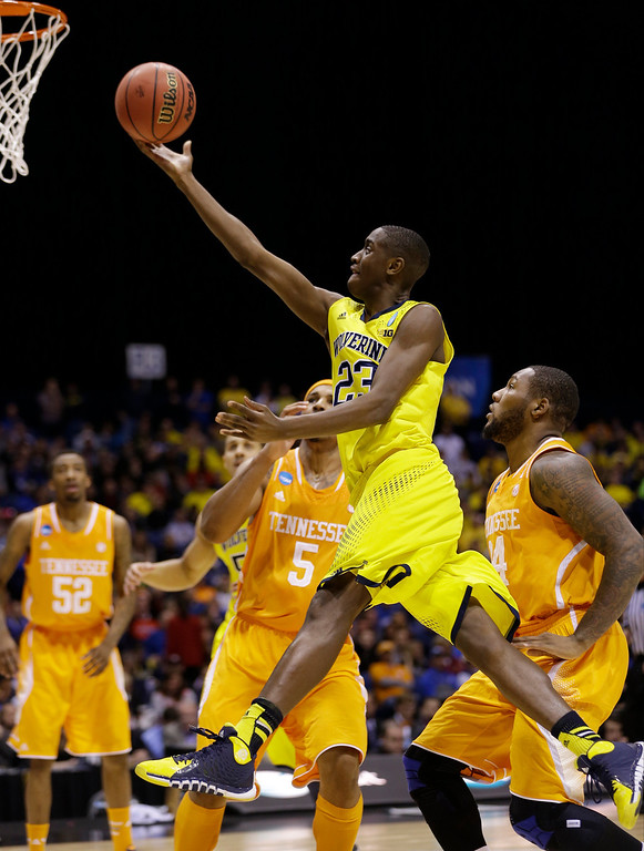 . Michigan\'s Caris LeVert shoots during the first half of an NCAA Midwest Regional semifinal college basketball tournament game against the Tennessee Friday, March 28, 2014, in Indianapolis. (AP Photo/David J. Phillip)