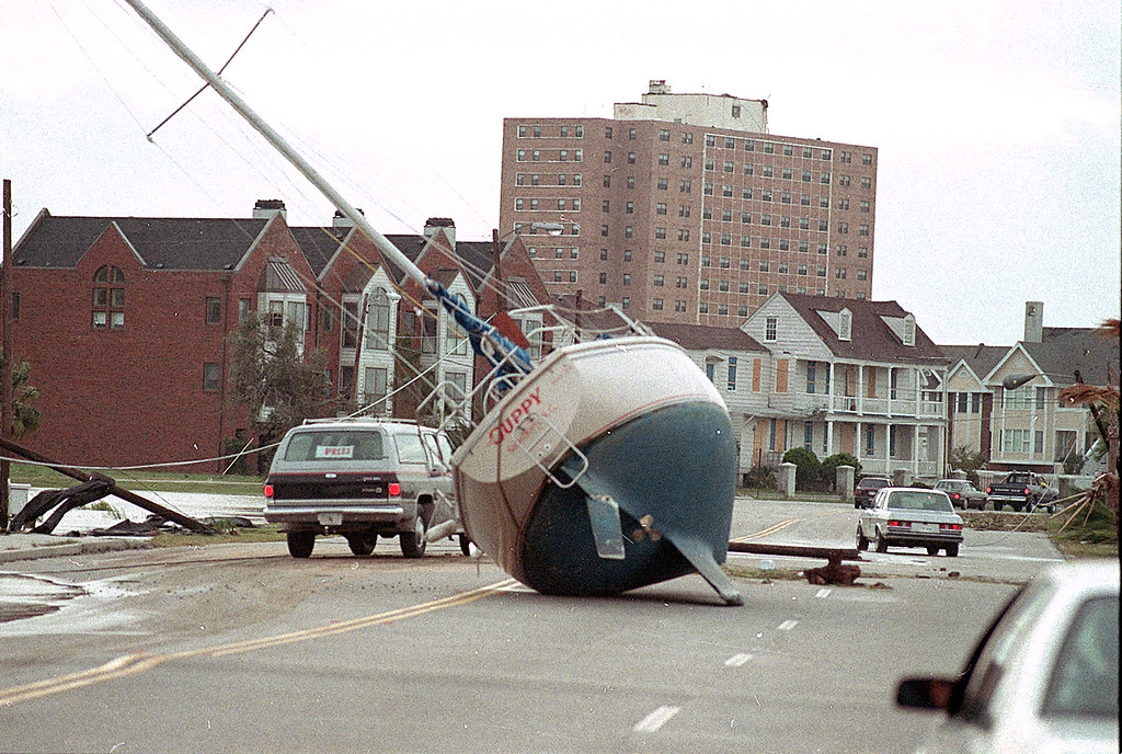 . A sailboat lies in the street of Charleston on Sept. 22, 1989 after it was washed ashore by Hurricane Hugo.  (AP Photo/Lou Krasky)