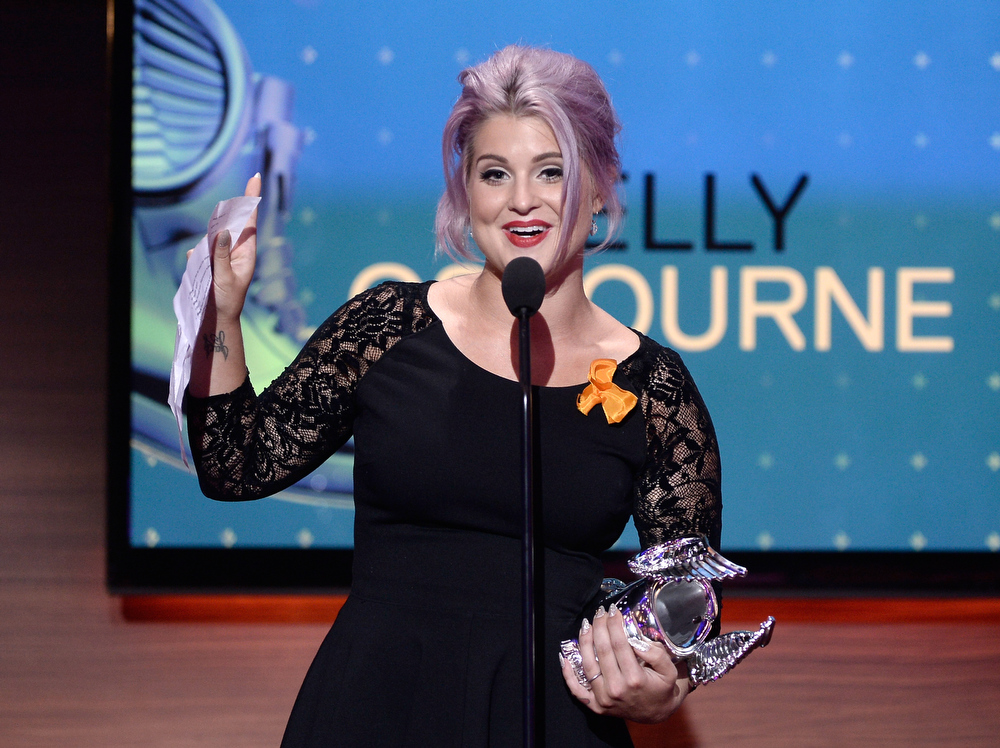 . Television personality Kelly Osbourne accepts award onstage at the DoSomething.org and VH1\'s 2013 Do Something Awards at Avalon on July 31, 2013 in Hollywood, California.  (Photo by Kevin Winter/Getty Images)