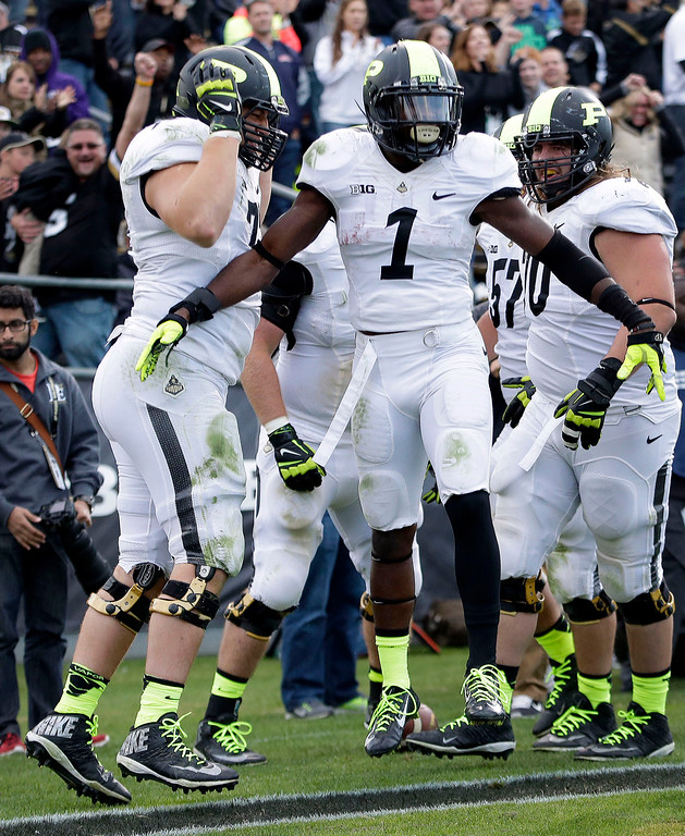 . Purdue running back Akeem Hunt (1) celebrates a touchdown in the fourth quarter of an NCAA college football game against Michigan State in West Lafayette, Ind., Saturday, Oct. 11, 2014. Michigan State won 45-31. (AP Photo/AJ Mast)