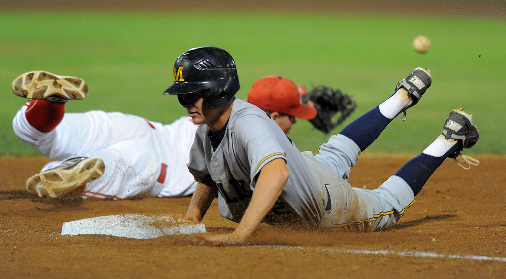 . LONG BEACH - 05/01/13 - (Photo: Scott Varley, Los Angeles Newspaper Group)  Lakewood vs Millikan baseball at Blair Field. Millikan\'s Johnathan Conroy gets back to first base safely as Lakewood\'s Nick Reeser dives to try to grab a wide throw from the catcher.