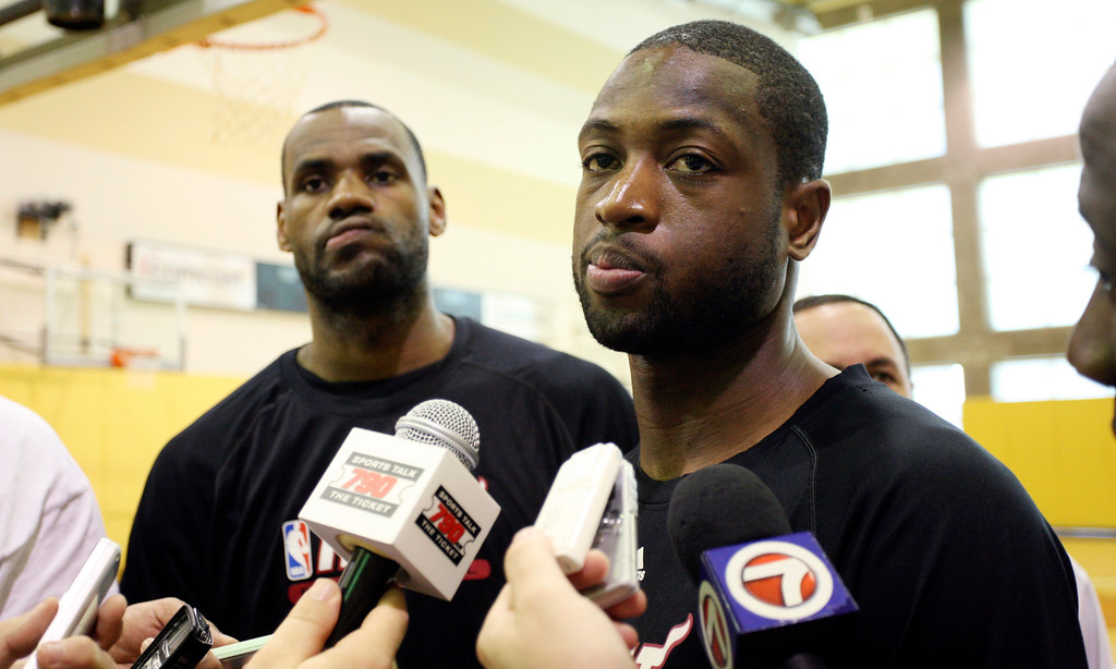 . Miami Heat basketball players LeBron James (left) and Dwyane Wade talk to the media after a practice session in Miami, Sunday, May 29, 2011.  The Heat will play the Dallas Mavericks in Game 1 of the NBA basketball finals on Tuesday.  (AP Photo/J Pat Carter)