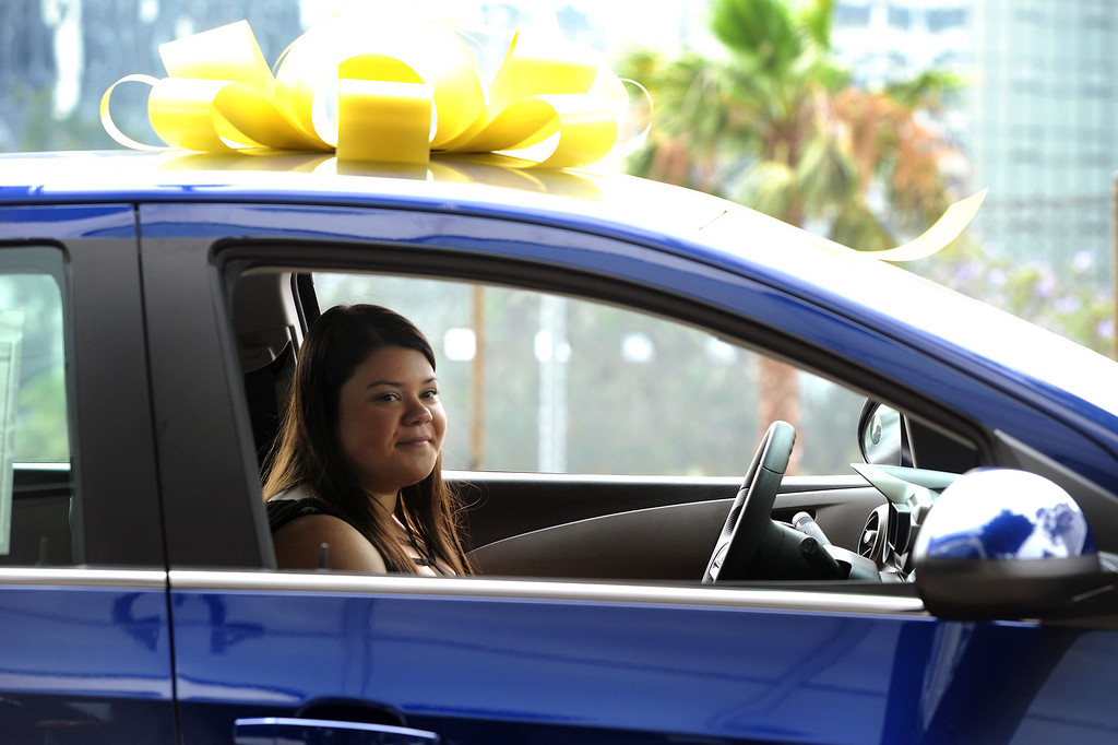 . Vanessa Umana, a 2013 graduate of Poly High School sits behind the wheel of the new Chevrolet Sonic awarded to her by LAUSD, Thursday, June 13, 2013, for perfect attendance for the 2012-13 school year. (Michael Owen Baker/Staff Photographer)