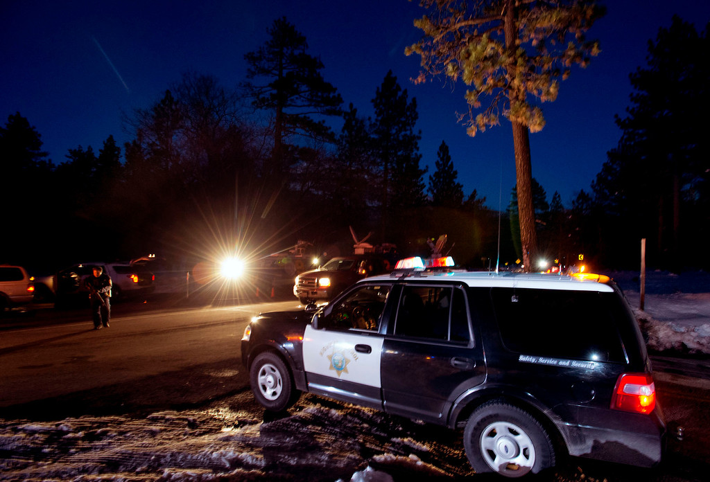 . California Highway Patrol officers block off Highway 38 south of Big Bear City after a deputy shootout with Christopher Dorner in the San Bernardino National Forest on Tuesday evening, Feb. 12, 2013. Dorner is believed to be dead after cabin fire after the shootout. (SGVN/Staff photo by Watchara Phomicinda)