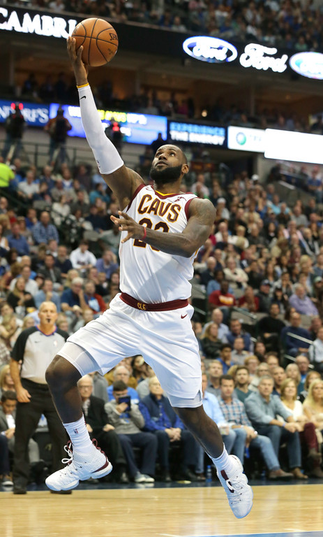 . Cleveland Cavaliers forward LeBron James (23) lays up a shot during the first half of an NBA basketball game against the Dallas Mavericks in Dallas, Saturday, Nov. 11, 2017. (AP Photo/LM Otero)