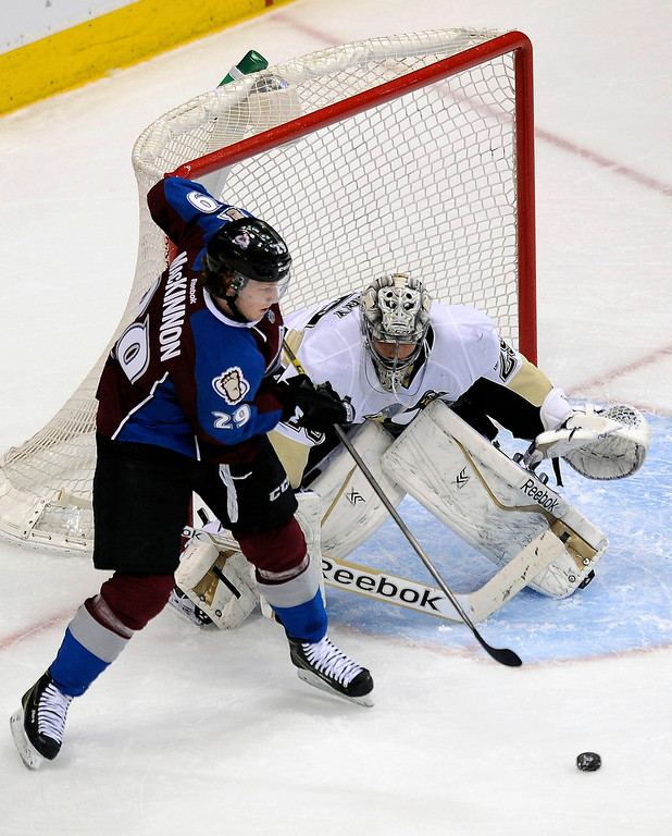 . Colorado Avalanche center Nathan MacKinnon tries to score on Pittsburgh Penguins goalie Marc-Andre Fleury during the first period of an NHL hockey game Sunday, April 6, 2014, in Denver. (AP Photo/Chris Schneider)