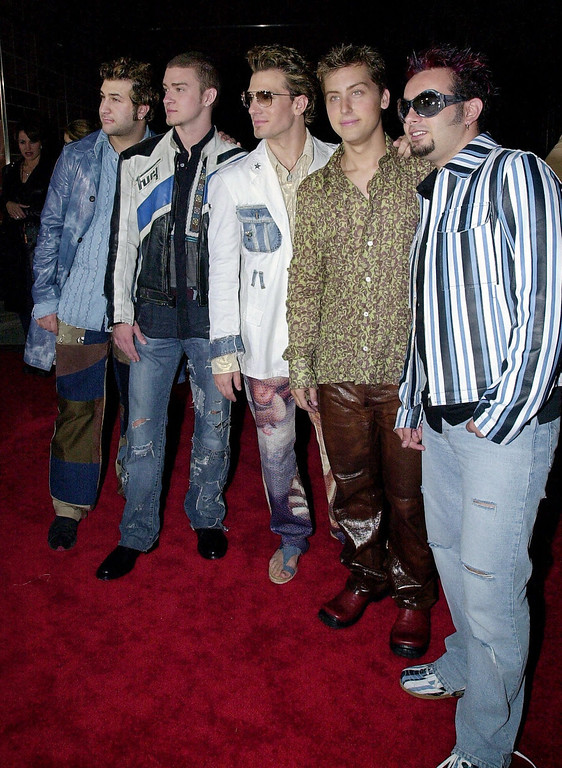 ". Members of the music group \'N Sync, from left, Joseph ""Joey\"" Fatone, Jr., Justin Timberlake, Joshua \""JC\"" Chasez, James Lance Bass and Chris Kirkpatrick pose at the premiere of their IMAX movie \""\'N Sync-Bigger Than Live,\"" Friday night, March 30, 2001, in Los Angeles. (AP Photo/Mark J. Terrill)"
