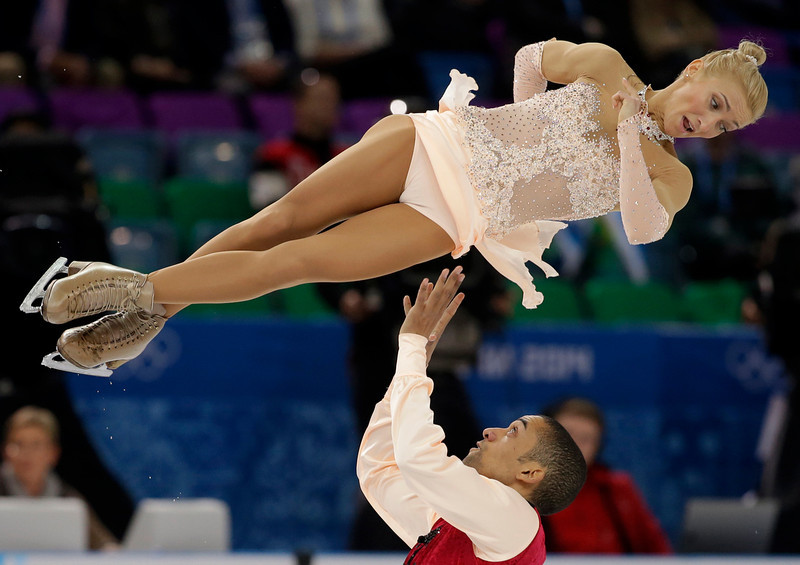 . Aliona Savchenko and Robin Szolkowy of Germany compete in the pairs free skate figure skating competition at the Iceberg Skating Palace during the 2014 Winter Olympics, Wednesday, Feb. 12, 2014, in Sochi, Russia. (AP Photo/Darron Cummings)