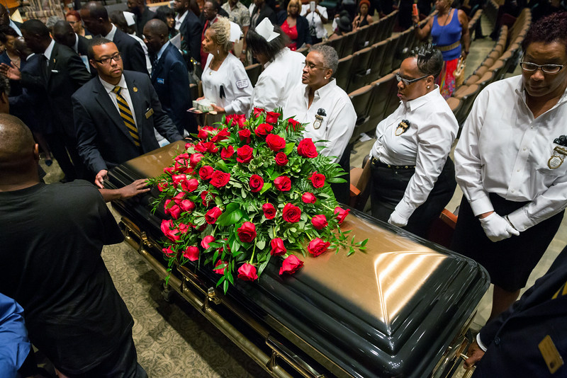 . A casket containing the body of Michael Brown is wheeled out Monday, Aug. 25, 2014, at Friendly Temple Missionary Baptist Church in St. Louis. Hundreds of people gathered to say goodbye to Brown, who was shot and killed by a Ferguson, Mo., police officer on Aug. 9. (AP Photo/New York Times, Richard Perry, Pool)