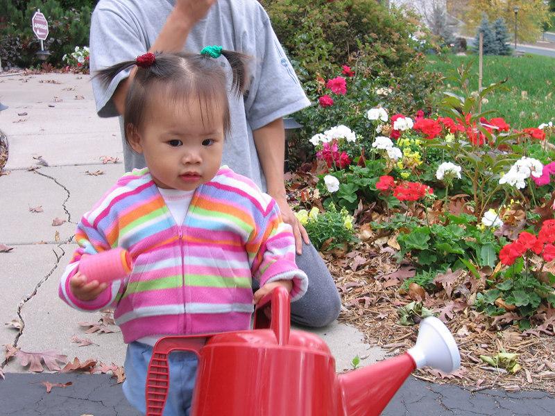 oct 08, 06 watering the flowers.jpg