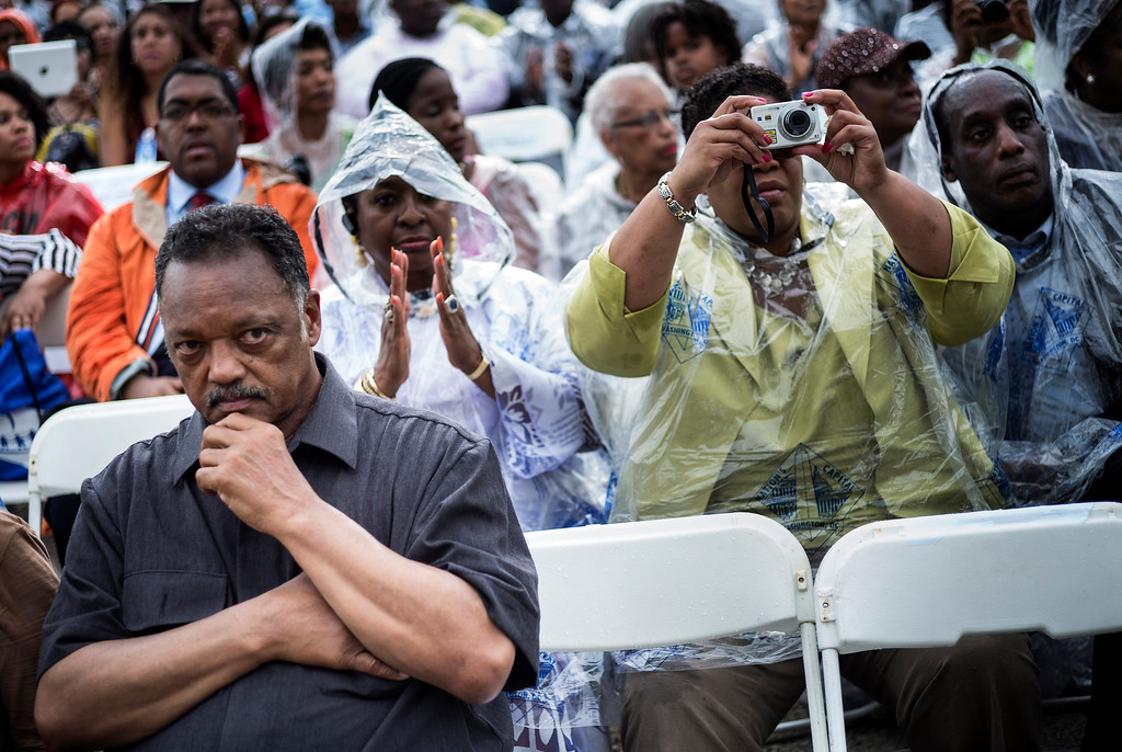 """. The Reverend Jesse Jackson and other wait to listen to US President Barack Obama speak at the Lincoln Memorial on the National Mall August 28, 2013 in Washington, DC. Obama and others spoke to commemorate the 50th anniversary of the US civil rights era March on Washington where Martin Luther King Jr. delivered his \""""I Have a Dream Speech\"""". AFP PHOTO/Brendan SMIALOWSKI/AFP/Getty Images"""