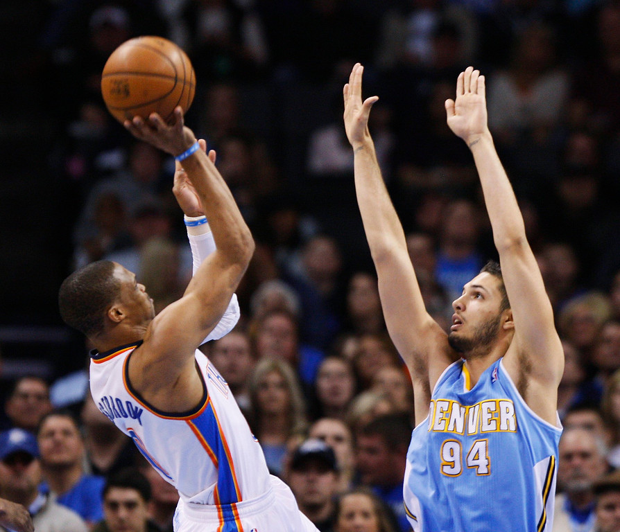 . Oklahoma City Thunder guard Russell Westbrook (L) shoots against Denver Nuggets guard Evan Fournier in the first half of their NBA basketball game in Oklahoma City, Oklahoma January 16, 2013. REUTERS/Bill Waugh