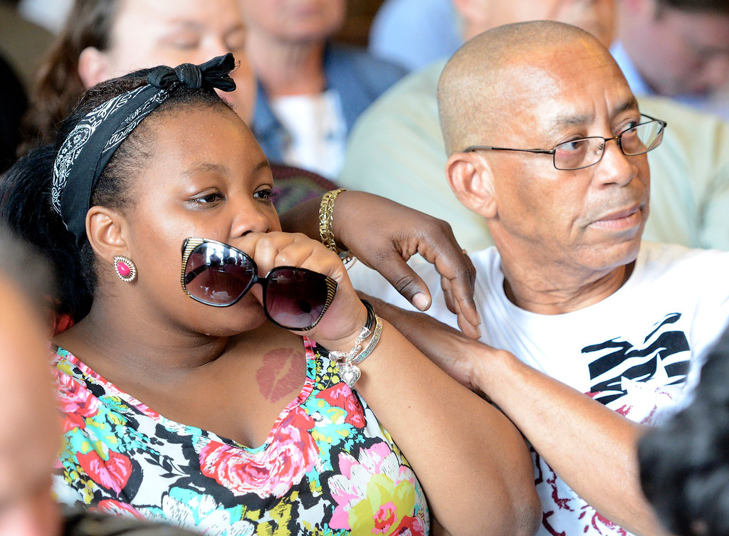 . Relatives of Odin Lloyd embrace as former New England Patriots tight end Aaron Hernandez appears in Attleboro District Court to face murder charges in relation to the death of a friend, in Attleboro, Massachusetts, USA 26 June 2013. Hernandez was arrested at his home earlier in the day. The body of 27-year-old Odin Lloyd, an acquaintance of Hernandez, and a semi-pro football player, was found 17 June 2013 in an industrial area about 1 mile (1.6 km) from the home of Hernandez.  EPA/MIKE GEORGE/SUN CHRONICLE/POOL