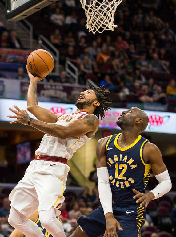 . Cleveland Cavaliers\' Derrick Rose (1) takes a shot under pressure from Indiana Pacers\' Damien Wilkins (12) during the second quarter of an NBA preseason basketball game, Friday, Oct. 6, 2017, in Cleveland. (AP Photo/Scott R. Galvin)