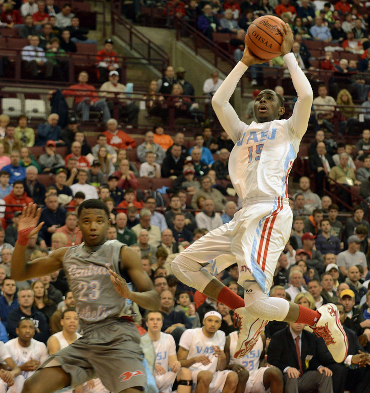 . Duncan Scott/DScott@News-Herald.com VASJ\'s Simon Texidor IV scores in the third quarter of VASJ\'s 64-62 loss to Lima Central Catholic in the Division III state championship game on March 22 in the Value City Arena in the  Schottenstein Center in Columbus.