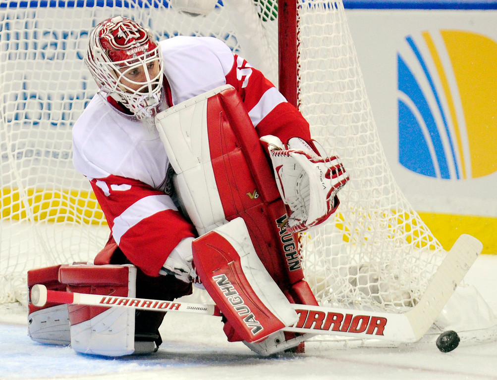 . Detroit Red Wings goaltender Jimmy Howard turns away a shot during the first period of an NHL hockey game against the Buffalo Sabres, Sunday, Nov. 2, 2014, in Buffalo, N.Y. (AP Photo/Gary Wiepert)