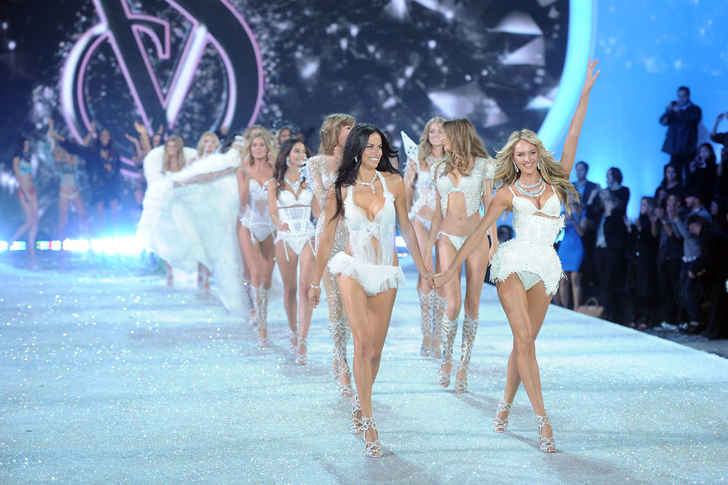 . Models Adriana Lima and Candice Swanepoel walk the runway at the 2013 Victoria\'s Secret Fashion Show at Lexington Avenue Armory on November 13, 2013 in New York City.  (Photo by Jamie McCarthy/Getty Images)